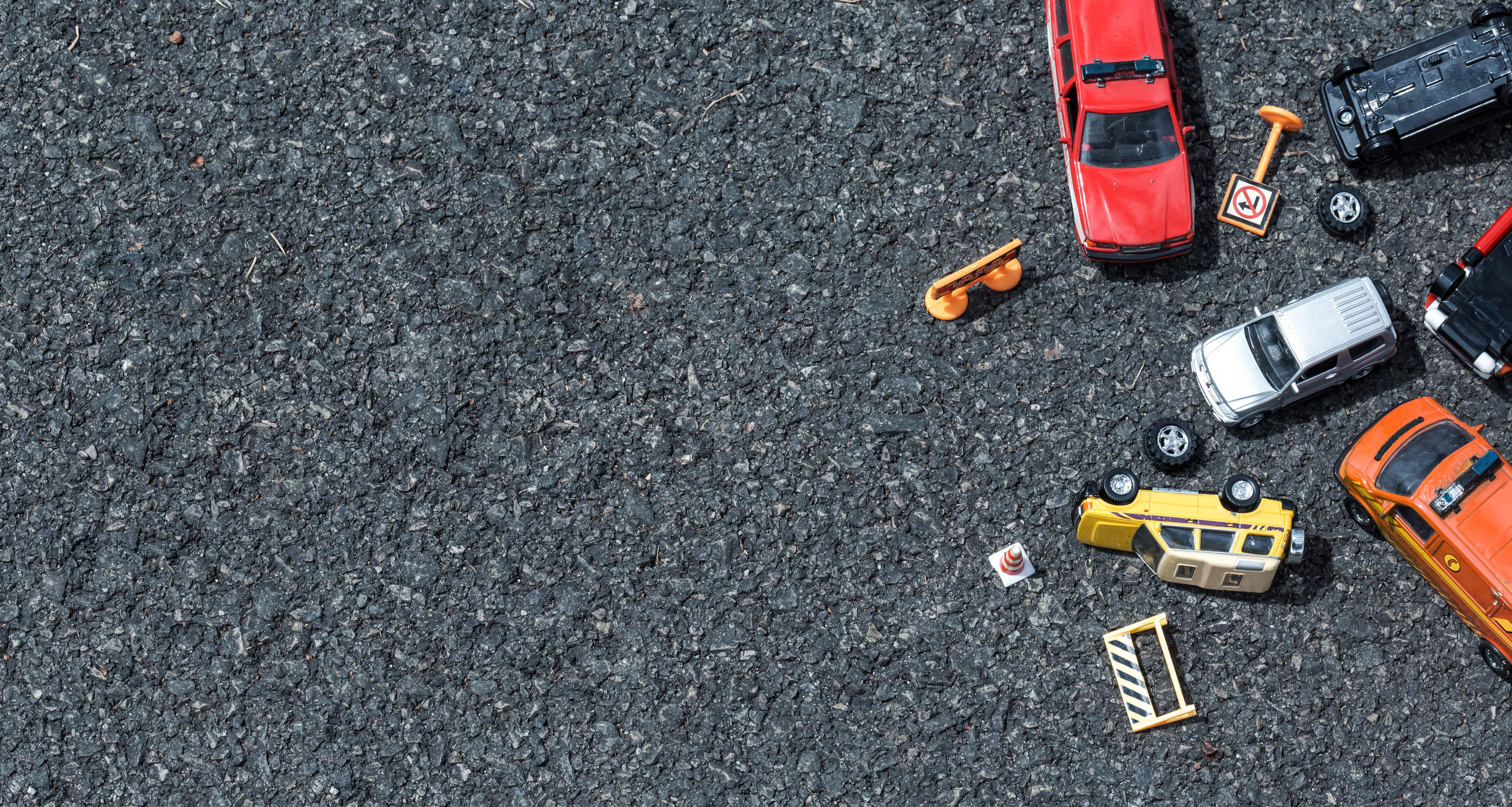minature cars on street for car accident
