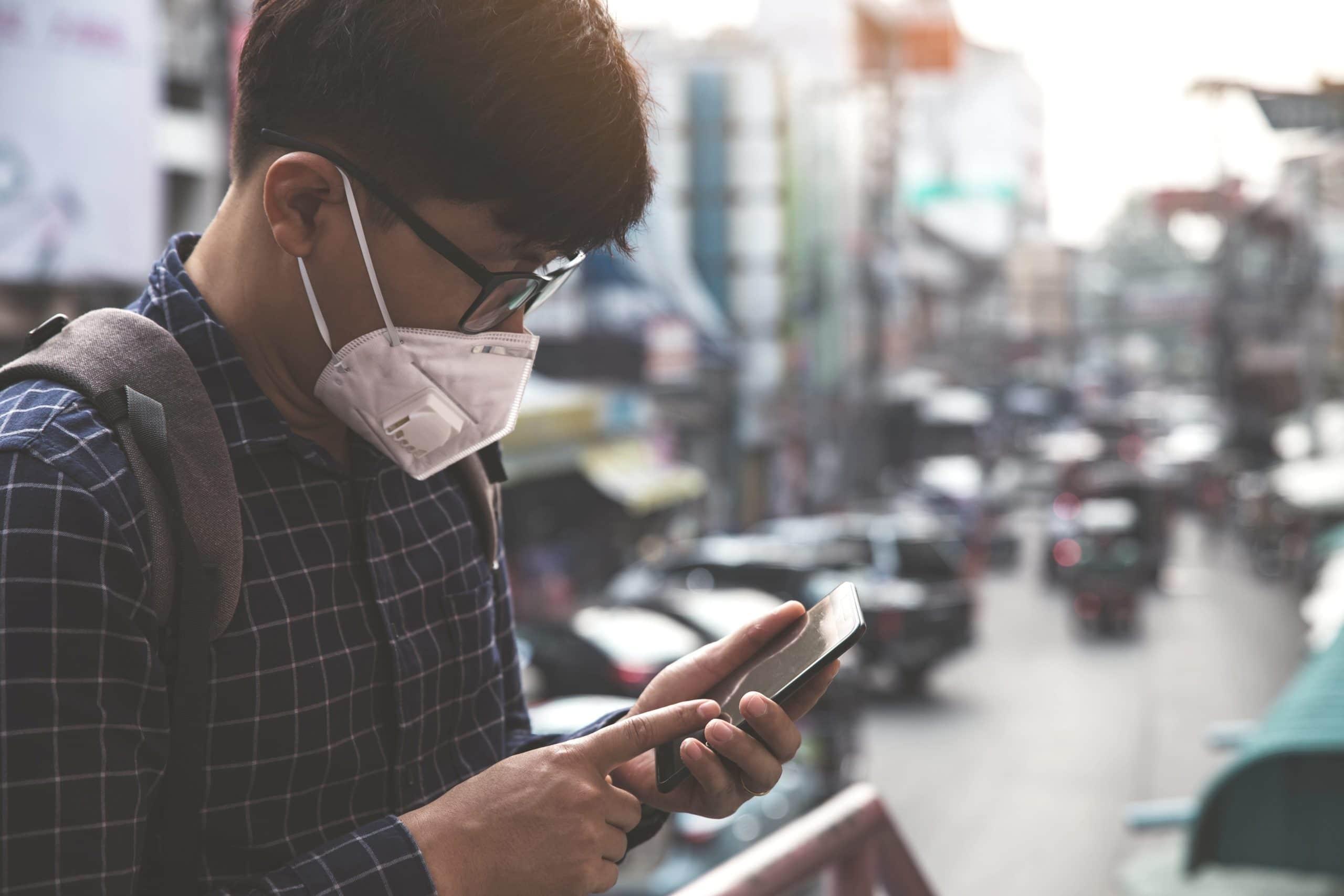 car accident victim calling on phone during coronavirus pandemic
